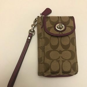 Coach wristlet cell phone wallet.